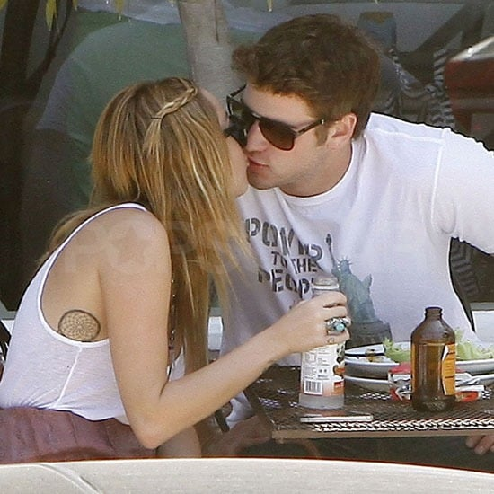 Miley Cyrus and Liam Hemsworth shared a kiss at lunch.