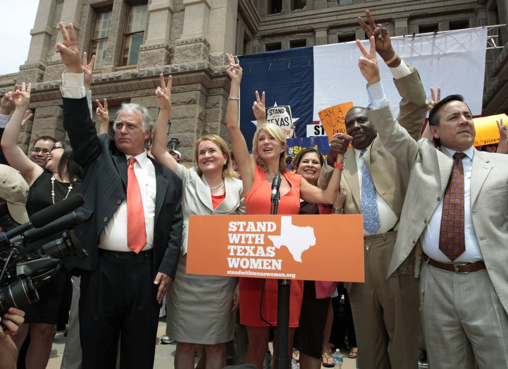 Pro-choice Texas representatives and senators held up peace signs during the rally.