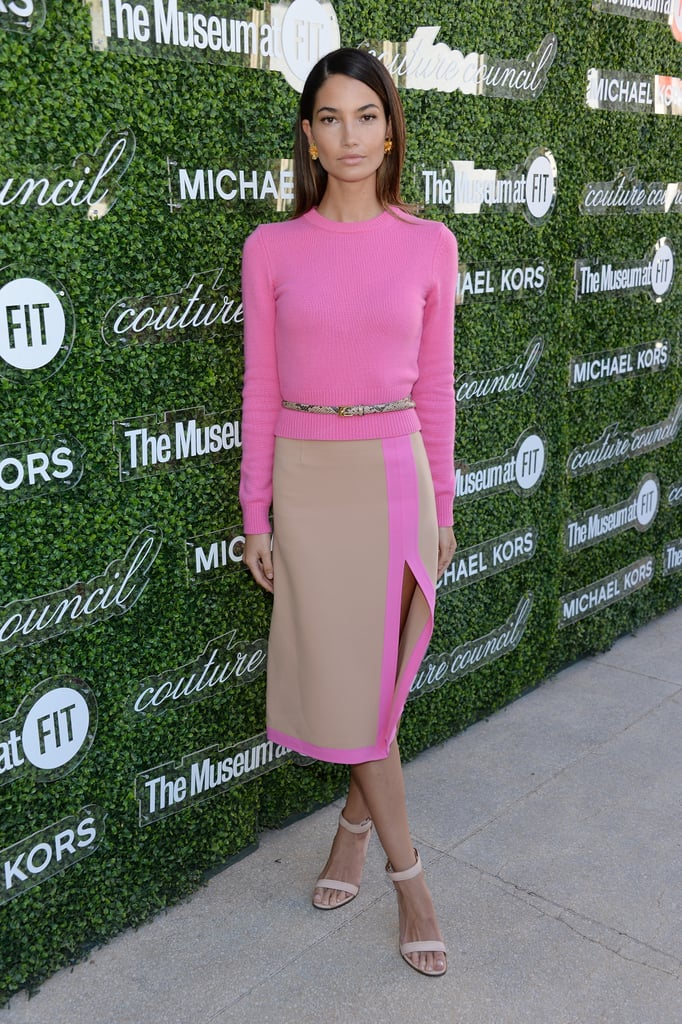 Lily Aldridge popped in a pink Michael Kors duo, tempered with nude, at the 2013 Couture Council Fashion Visionary Awards in NYC. Ofira white diamond and yellow gold earrings added a fancy finish. Where to Wear: Straight from the office to dinner with your SO.