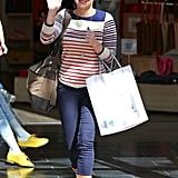 The Fourth of July would be super comfy and cute in Anna Faris's style. Find a red, white, and blue striped top, then add dark denim and tan boots.