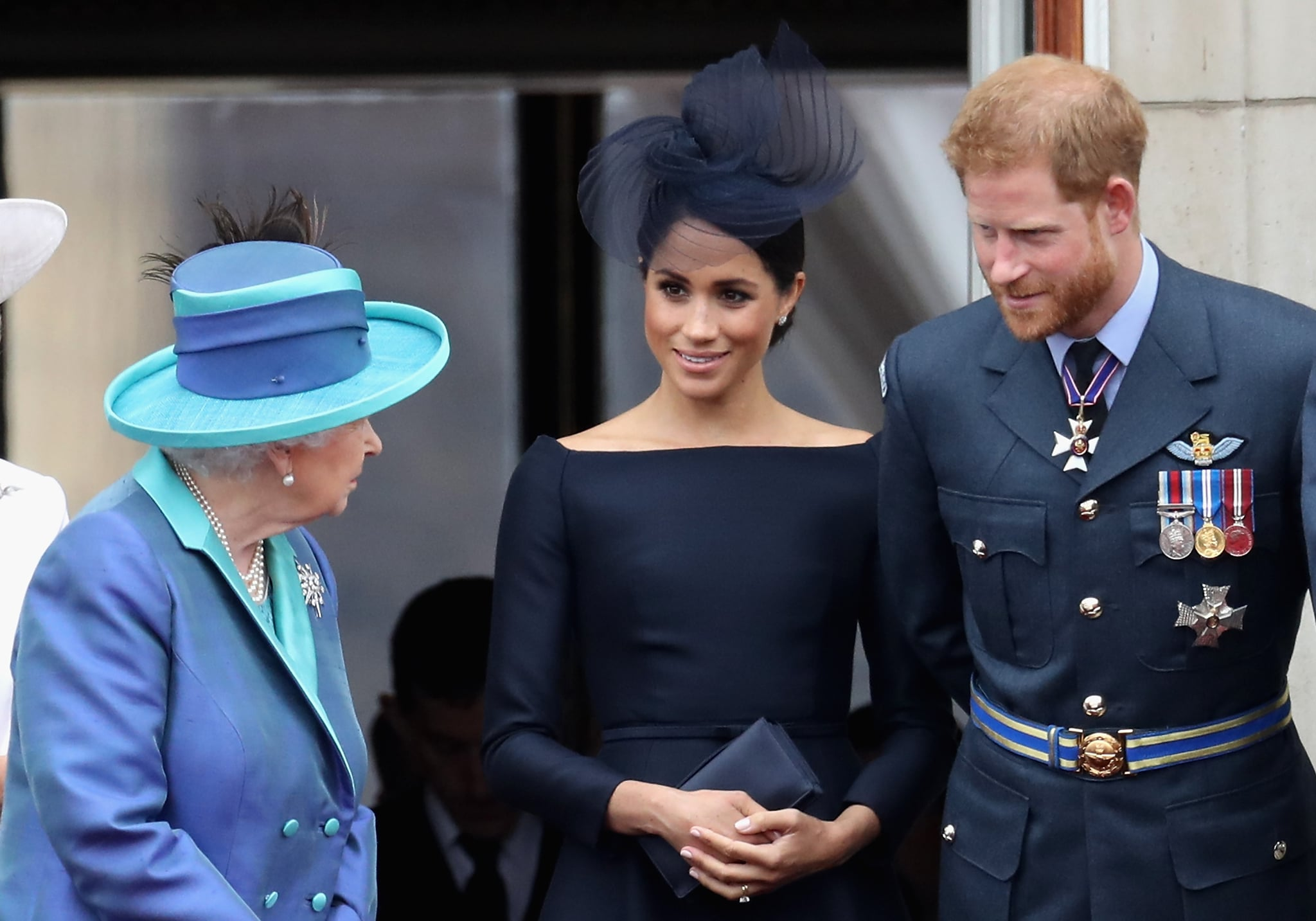 LONDON, ENGLAND - JULY 10:  (L-R)  Queen Elizabeth II, Meghan, Duchess of Sussex, Prince Harry, Duke of Sussex watch the RAF flypast on the balcony of Buckingham Palace, as members of the Royal Family attend events to mark the centenary of the RAF on July 10, 2018 in London, England.  (Photo by Chris Jackson/Getty Images)