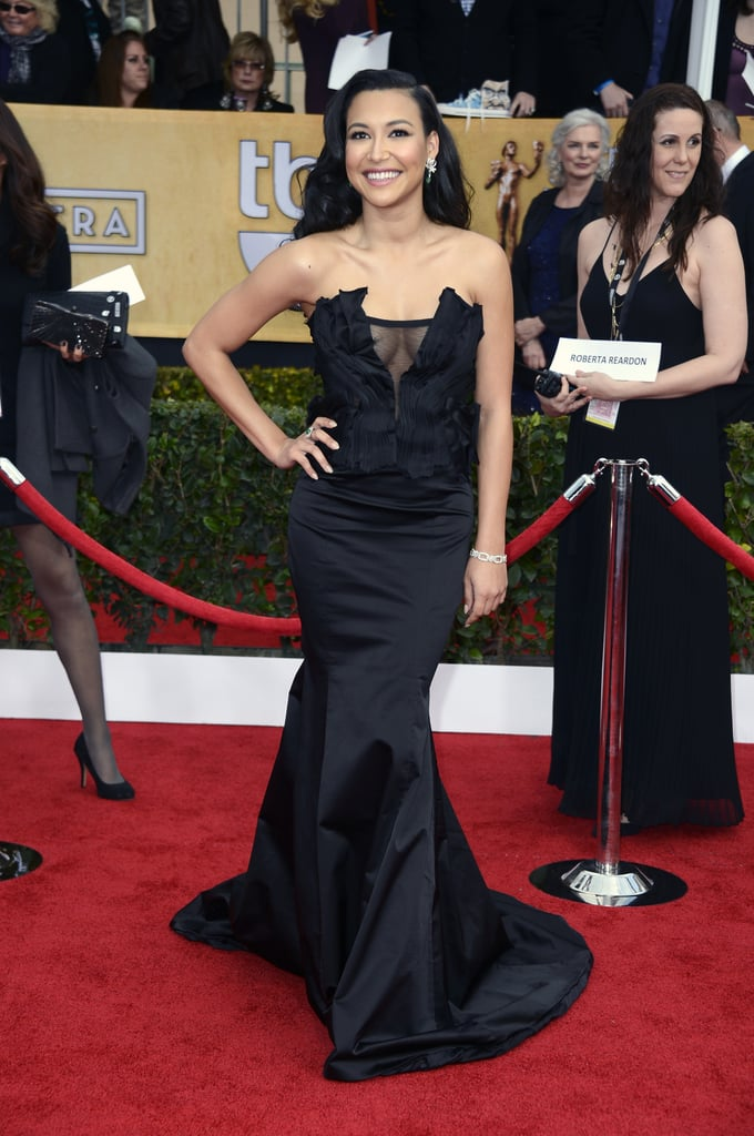 Naya Rivera's Donna Karan Atelier gown revealed a little decolletage with a sheer inset and drew attention to her curves with a fishtail hemline.