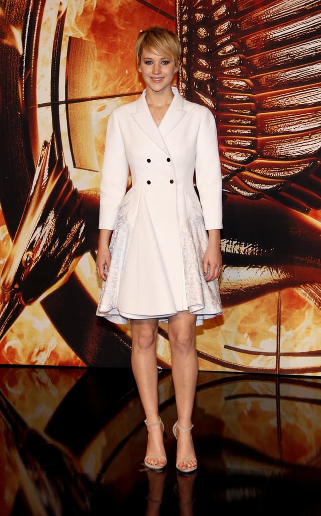 Jennifer Lawrence stunned in a Dior coat dress and Stuart Weitzman sandals at The Hunger Games: Catching Fire's Germany premiere.