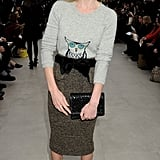 Kate Bosworth looks super cute in an owl-print sweater and tweed skirt at the Burberry show.
