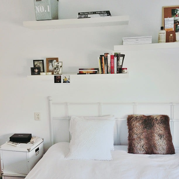 Bookcase Around Bed: White Shelving Practically Disappears Against Matching