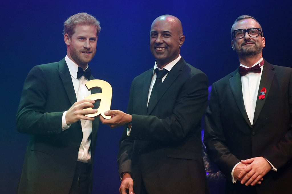 "After attending the annual 100 Women in Finance Gala on Wednesday, Prince Harry stepped out in his tux once again for the Attitude Awards in London on Thursday. The royal received the legacy award on behalf of his late mother, Princess Diana, who was honored for her significant work with HIV/AIDs and challenging the stigma that surrounding the disease in the '80s. In his speech, Harry said Diana ""felt a responsibility to shine her spotlight on the people and issues that were often ignored. She knew that AIDS was one of the things that many wanted to ignore and seemed like a hopeless challenge.""       Related:                                                                                                           13 Sweet, Heartbreaking Things William and Harry Have Said About Princess Diana               Diana was a patron of more than 100 causes around the world, some of which Prince William and Prince Harry now champion. One of those charities was the National AIDS Trust, which promotes the awareness of AIDS and helps prevent the spread of HIV. In April 1987, Diana challenged the notion that HIV/AIDS was passed on by touch when she shook the hand of a dying AIDS patient without wearing gloves during a visit UK's first AIDS ward at Middlesex hospital.  Other stars honored at the ceremony included Laverne Cox, Nyle DiMarco, Kylie Minogue, and Charli XCX.   Prince Harry accepting the Legacy Award at this year's #AttitudeAwards on behalf of his mother Princess Diana's HIV/AIDS activism 🌈 pic.twitter.com/ViVxCWdqnR— Attitude (@AttitudeMag) October 12, 2017"