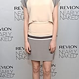 Emma Stone wore a gray and ivory dress for Revlon's launch in NYC.