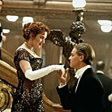 Showing off their formalwear, Jack kisses Rose's glove-covered hand.