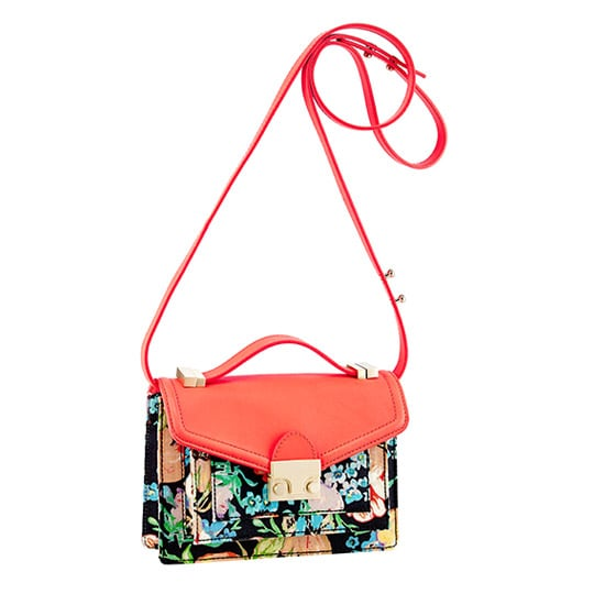 When I first spotted this floral Loeffler Randall bag ($395) in all its printed glory, I knew it had to be mine. Aside from its bold beauty and polished gold push lock, it's the perfect size to hold all of my Spring essentials. I'll pair it with denim cutoffs and a cozy cardigan — utilizing the adjustable shoulder strap for hands-free fun — during the day, then pump up my LBD with the clutch version at night. — Mandi Villa