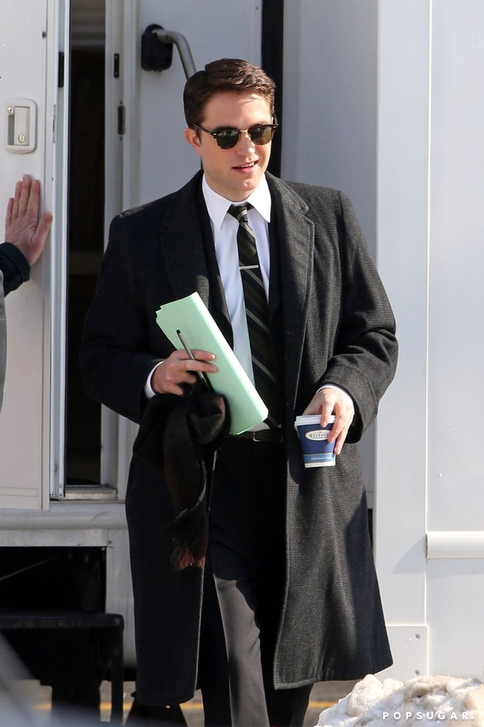 After debuting his new black hair, Robert Pattinson got back to work on the set of his latest film, Life, in Toronto on Wednesday. The actor was dressed very differently from the first time we saw him on set, trading the dapper vintage suit for his usual uniform of jeans, a sweatshirt, and a jacket. However, he later got back into hist suit to film a street scene. In Life, Robert plays the magazine's famed photographer Dennis Stock, as he attempts to photograph James Dean (who will be played by Dane DeHaan). While Robert is perhaps best known for his role of Edward Cullen in the Twilight series, he has a slew of post-vampire-life films coming out this year and in 2015, starting with The Rover this Summer. Rob will also appear in Maps to Our Stars alongside Mia Wasikowska, Julianne Moore, and John Cusack. He has a busy time ahead of him as he is slated to start work on The Lost City of Z and The Childhood of a Leader later this year.