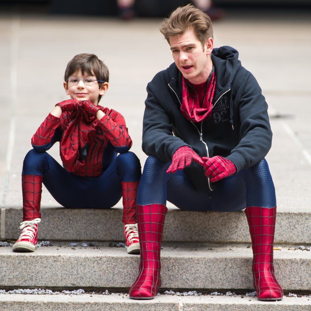 Andrew Garfield continued shooting The Amazing Spider-Man 2 in NYC today with a special little castmate. He took a seat with a young actor, and shared a few words and laughs between takes. Elsewhere on set Paul Giamatti — who plays one of the film's resident villains, The Rhino — got geared up for more action-filled shoots. While Paul channeled his inner bad guy, it's clear Andrew has taken a liking to working, and playing, with a younger crowd. Last week, Andrew may have also hit an NYC playground to play basketball with neighborhood kids while off the set. In a video released on YouTube, it appeared to be a Spidey-disguised Andrew shooting hoops before saying goodbye to his new friends and taking off down the street with a woman resembling his girlfriend, Emma Stone, along with their golden retriever. Whether or not it was Andrew, he and his canine pal did get in time with an older friend the following day when they hung out with Andrew's pal Tom Sturridge.