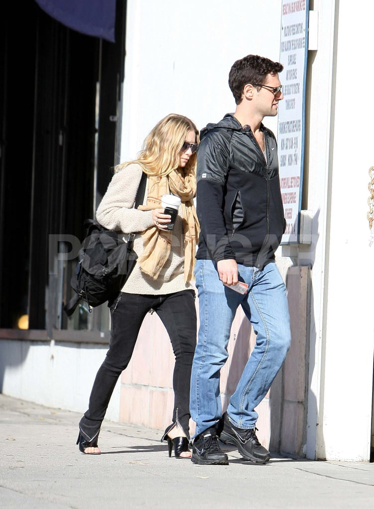 Ashley Olsen and Justin Bartha wore shades to shop in LA yesterday. As usual, she has been bouncing between the East and West Coasts for work with her sister Mary-Kate, though Ashley also took a quick trip to St. Bart's last month. She was there with Justin, and the getaway included plenty of bikini time for Ashley. Justin has his own business to tend to in the New Year, with the highly anticipated release of The Hangover 2 in May. Ashley and Justin have apparently been looking at apartments in NYC, though for now they're happy to spend their time together on the other side of the country.