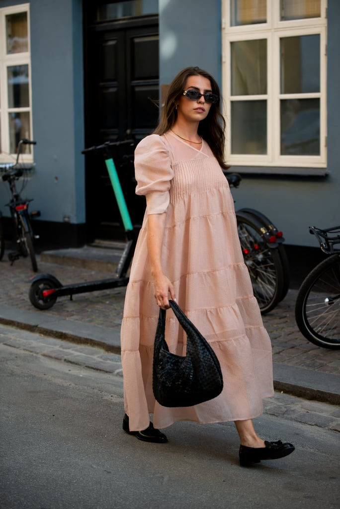 Keep it comfy with a puff-sleeve maxi dress, flats, and an unstructured bag
