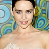 Emilia Clarke opted for a sleek middle-parted updo that she accented with subtle makeup shades.