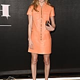 Only someone this stylish could pull off an orange, leather Coach dress.