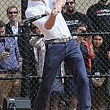 Prince Harry hit a baseball on Tuesday while playing with a youth team in Harlem, NYC.
