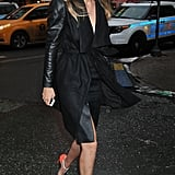 She showed off her stems in a slick pencil skirt and belted coat, and she added interest with colorblocked heels.