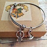 Sorting Hat and Snake Charm Bracelet ($17)