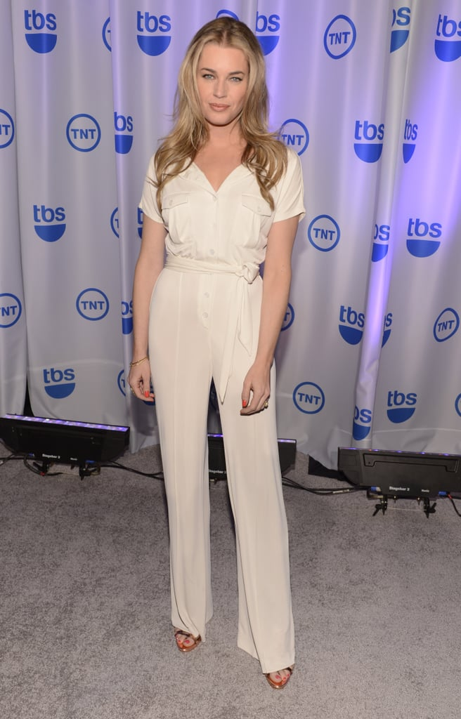 Rebecca Romijn ditched the dress in lieu of an equally eye-catching white jumpsuit at the TNT/TBS upfronts in NYC.