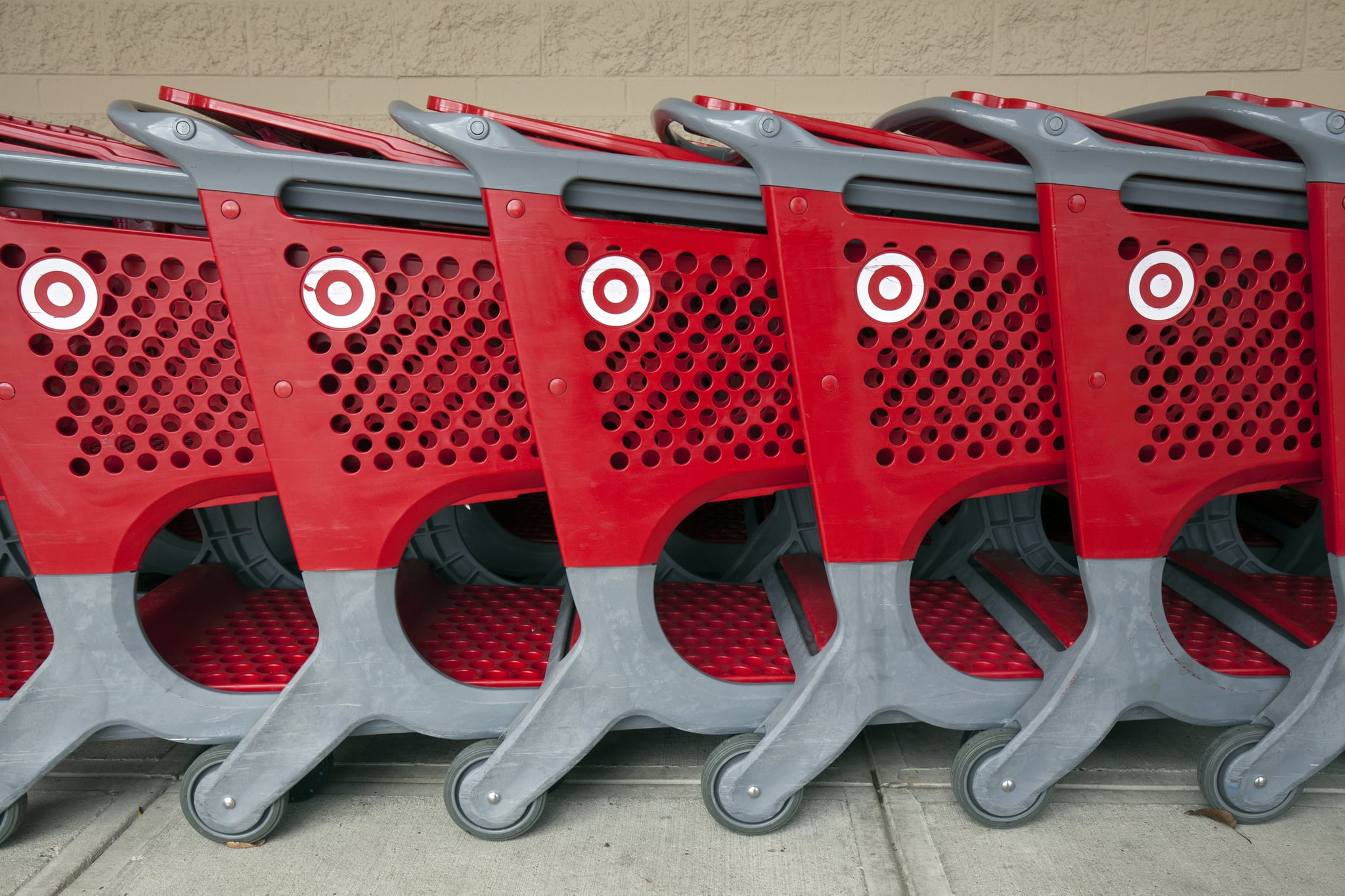 View of branded shopping carts lined up on a sidewalk outside a Target store, Danvers, Massachusetts, November 2018. (Photo by Leif Skoogfors/Getty Images)