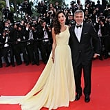 George and Amal attended the premiere of Money Monster at the 2016 Cannes Film Festival. She wore a yellow Atelier Versace gown that gave off modern Belle vibes.