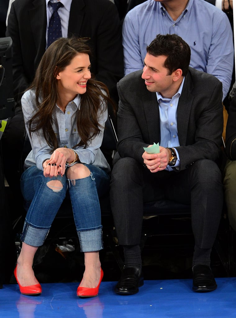 Katie Holmes sat courtside last night as the Golden State Warriors took on the New York Knicks at Madison Square Garden. Katie was joined by her agent, Adam Schweitzer, in the front row, where they watched the Knicks take home the win. She dressed casually for the event, adding a pop of team spirit with orange pumps and a lipstick shade to match. Katie's night out came without her usual companion, Suri Cruise, who recently spent time in London with dad Tom Cruise.  Katie is back on the East Coast after a quick trip to LA last week. She attended an exclusive dinner last Thursday, which was hosted by the ICM Partners agency. Katie didn't stick around to participate in Oscars festivities, despite attending Vanity Fair's afterparty with Tom by her side last year.