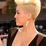 Miley Cyrus showed off her new hair style on the red carpet.