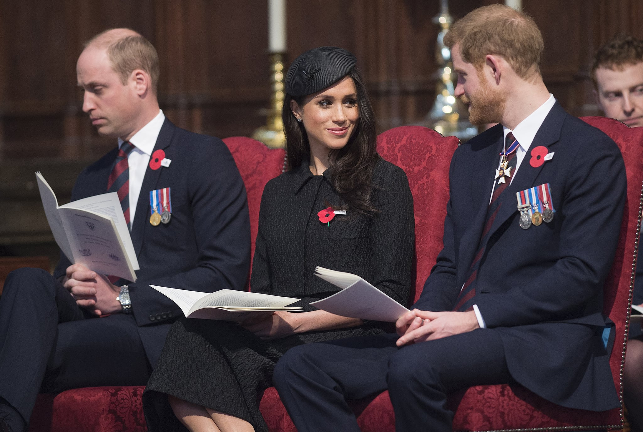 TOPSHOT - Britain's Prince Harry (R), his US fiancee Meghan Markle (C), and Britain's Prince William, Duke of Cambridge, attend a service of commemoration and thanksgiving to mark Anzac Day in Westminster Abbey in London on April 25, 2018. - Anzac Day marks the anniversary of the first major military action fought by Australian and New Zealand forces during the First World War. The Australian and New Zealand Army Corps (ANZAC) landed at Gallipoli in Turkey during World War I. (Photo by Eddie MULHOLLAND / POOL / AFP)        (Photo credit should read EDDIE MULHOLLAND/AFP/Getty Images)