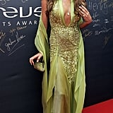 Wearing a Lime Green Gown With Gold Embellishments