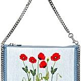 Stella McCartney 'Falabella' floral denim clutch ($620)