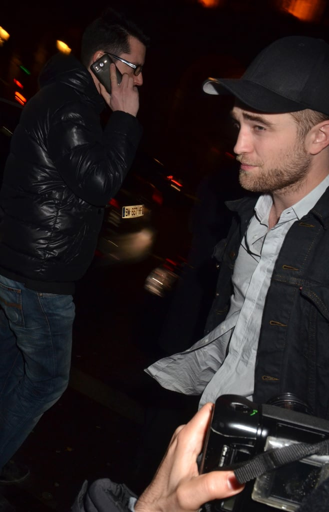 Robert Pattinson braved photographers at Paris's Museum of Decorative Arts.