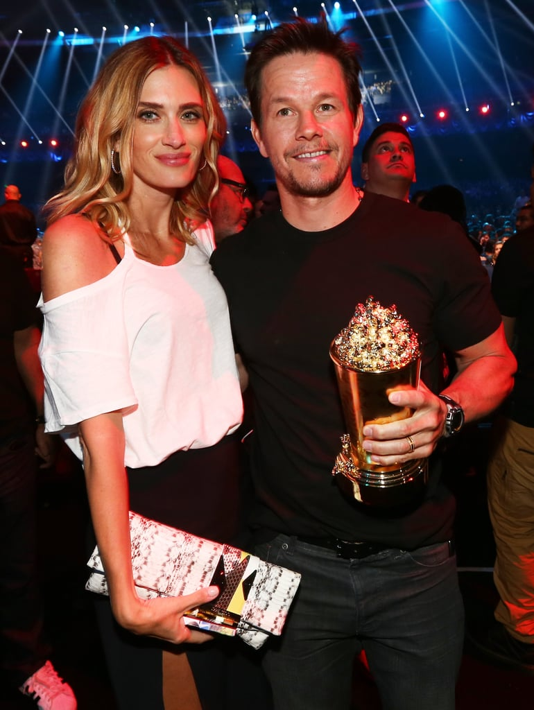 Mark Wahlberg posed with his popcorn and his wife.