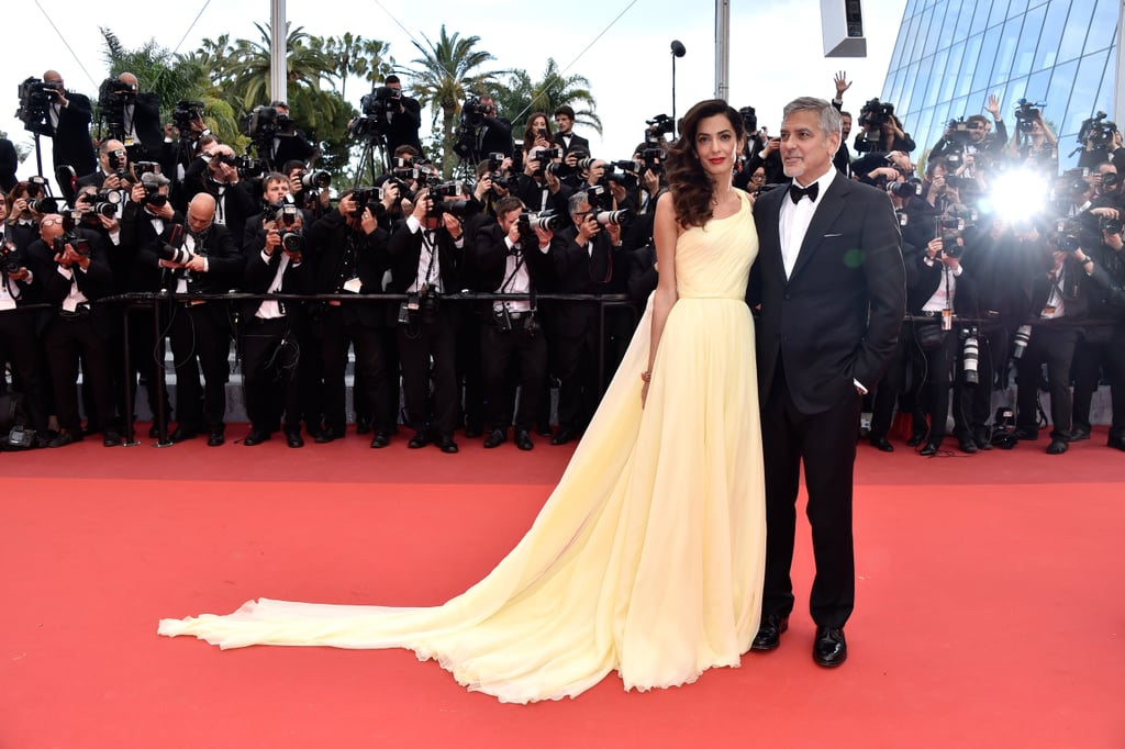 "George Clooney was unsurprisingly surrounded by gorgeous women when he hit the red carpet for the Cannes Film Festival premiere of his new movie, Money Monster, on Thursday. The actor was joined by his beautiful wife, Amal, who dazzled in a yellow Atelier Versace gown, as well as his costar Julia Roberts, with whom he shared a laugh while posing for photos. The group then headed inside along with director Jodie Foster for their big screening. Earlier in the day, Julia opened up about Amal in an interview with ET, saying that she ""changed"" George, adding, ""in a beautiful way that all wives kind of have a beautiful, loving influence over their husbands."" George and Julia, who are reuniting in Money Monster for the first time since working together on the Oceans trilogy, also showed off their singing chops during a recent Carpool Karaoke with Gwen Stefani and James Corden."