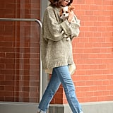 Selena stayed cozy in her sweater and cuffed jeans while holding her new puppy Charles. The star gave her sneakers a break by slipping into black open-back tassel loafers.