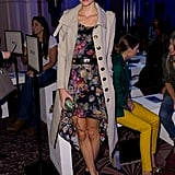 Poppy sat front row at the Anya Hindmarch show in a flirty floral dress with a long khaki trench coat. She finished the look with black ankle booties and a tiny clutch.