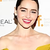 Hot-pink lips on Emilia Clarke were a stunning pairing against her golden frock at the premiere of Dom Hemingway.