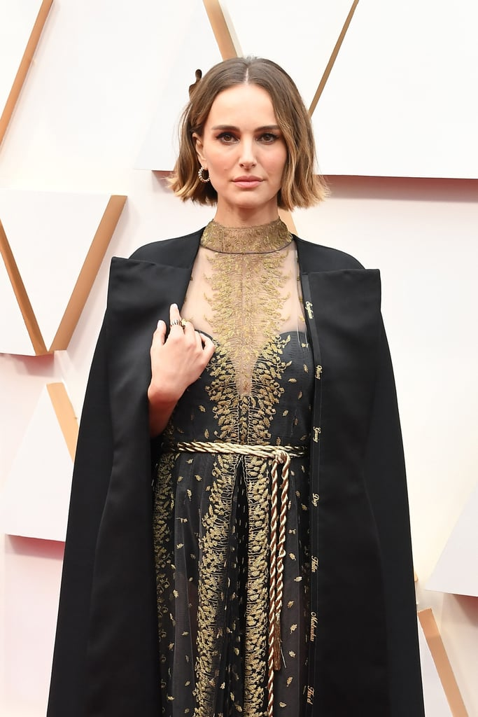 "Natalie Portman is sending a strong message at the Oscars without having to say a word. The Lucy in the Sky actress — who's presenting during tonight's show — walked the red carpet wearing a statement Dior cape, which at first glance might give you flashbacks to her Star Wars days. However, given a closer look, it's clear Natalie is standing in solidarity with the snubbed female directors who didn't receive nominations this year.  ""I wanted to recognize the women who were not recognized for their incredible work this year, in my subtle way,"" Natalie told reporter Amy Kaufman.  Natalie's cape is embroidered with the surnames of directors Lorene Scafaria, Lulu Wang, Greta Gerwig, Mati Diop, Marielle Heller, Melina Matsoukas, and Alma Har'el. Her outfit is a symbol of hope after the Academy faced much scrutiny and criticsm for shutting these women out of the best director category. Natalie is not one to stay silent on this issue of representation, and made waves across the internet two years ago for her pointed comment about the lack of female directors at the 2018 Golden Globes. Whether through fashion or fierce words, Natalie will let these fellow artists go ignored. Get a closer look at her cape, ahead."