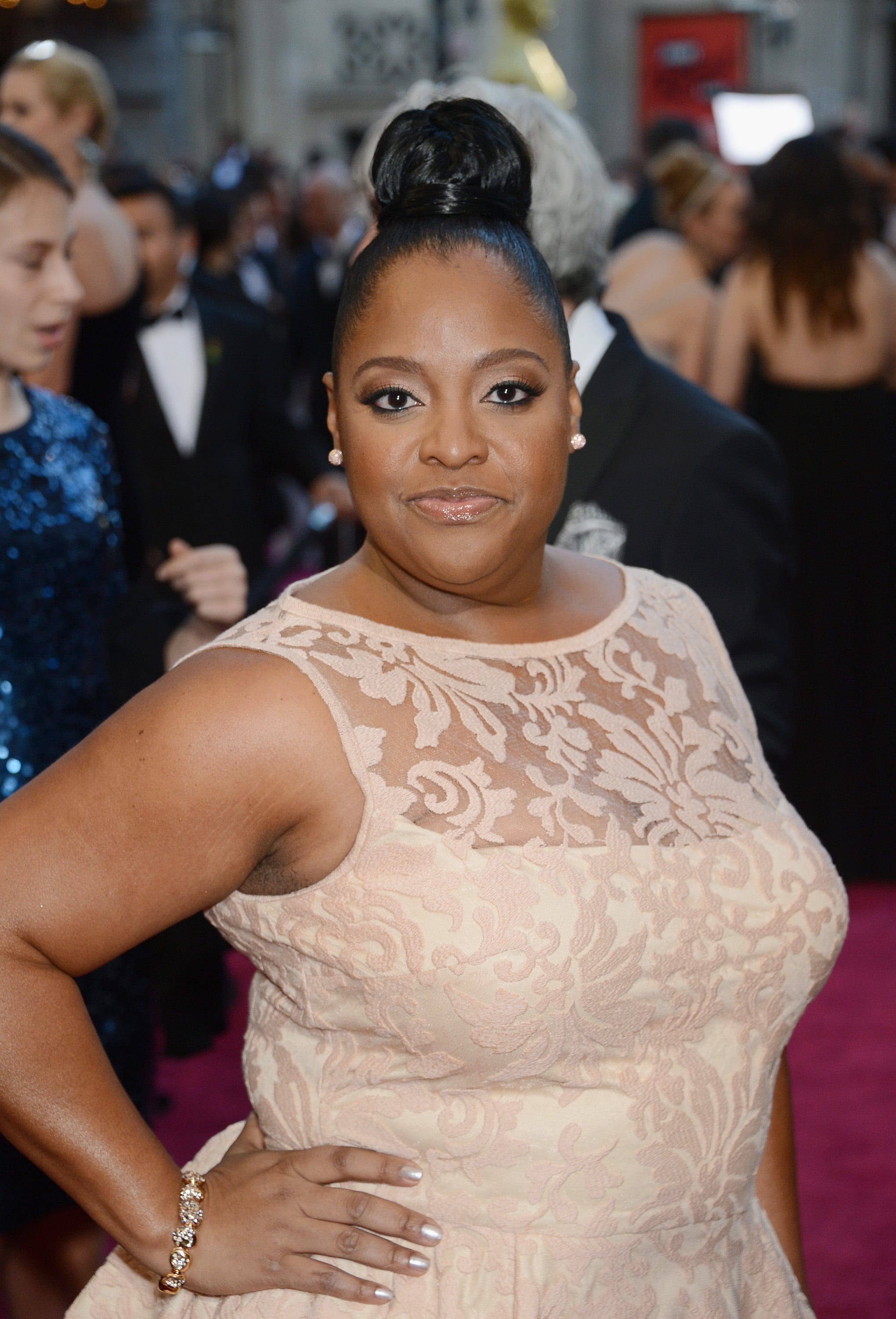 Sherri Shepherd's Oscars look featured a skyscraping bun that was topped off with a band of hair at the base.
