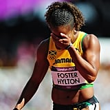 Jamaica's Brigitte Foster-Hylton of Jamaica covered her face after competing in her hurdles heat.