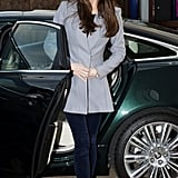 Kate wearing a gray blazer coat and jeans in October 2013.