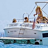 Avril Lavigne wore her bikini and sipped on a drink in St. Tropez.