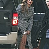 J Lo adjusted her skirt getting out of her SUV.
