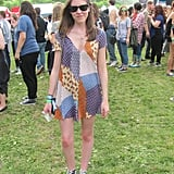 This festivalgoer kept her look comfy and chic in a patchwork Zara playsuit, Converse, and sunglasses.