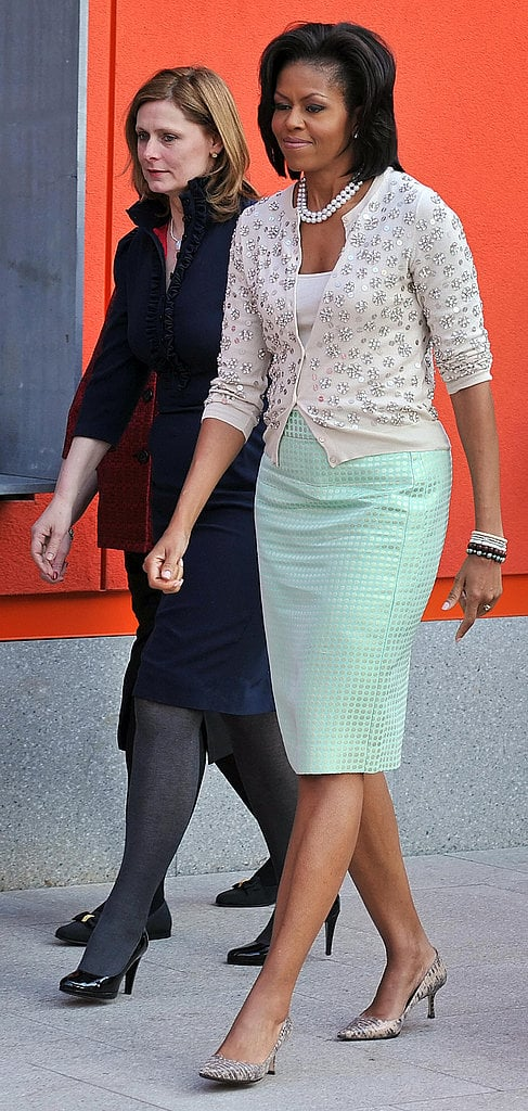 Michelle is known for her ability to mix-and-match high and low brands to perfection. She looked gorgeous in a jeweled cardigan and mint-colored J.Crew pencil skirt.