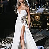 Wearing a White Roberto Cavalli Gown That Featured a High-Slit