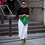 For a Classy Ensemble, Style a Sequinned Skirt With a Black Sweater