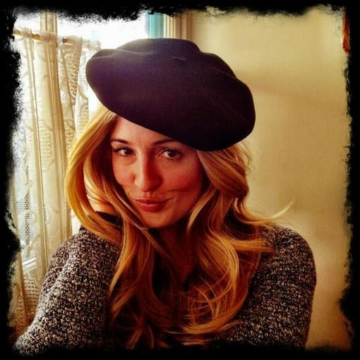 Cat Deeley dressed the part while eating at a French restaurant by sporting a beret.  Source: Twitter user catdeeley
