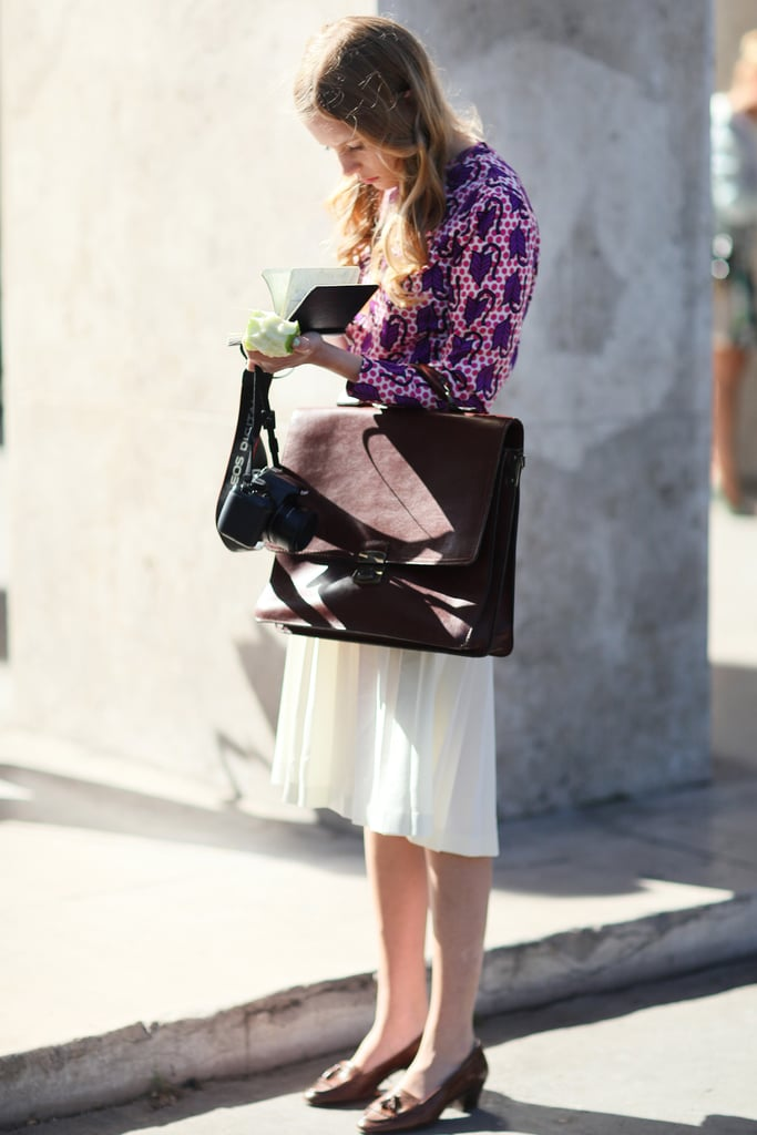 Ladylike and a little vintage with attention-getting add-ons, like that major satchel.