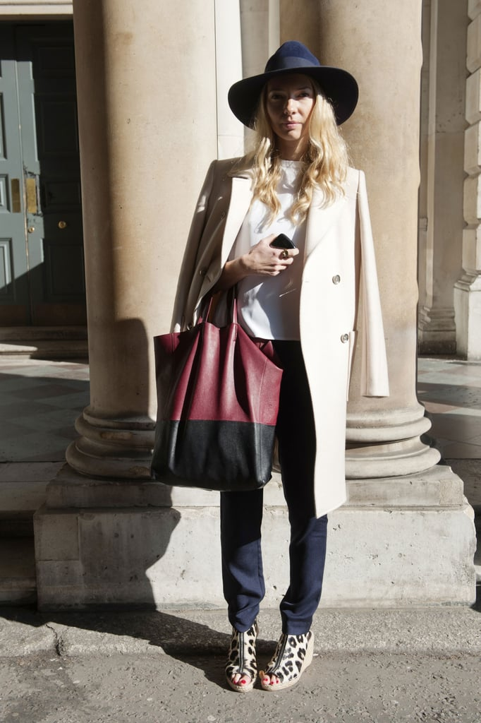 A crisp, creamy coat and colorblocked leather bag played minimalist opposites to leopard-print espadrilles.