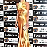 Wearing a gold high-neck gown at the Tokyo premiere of Tomorrowland in 2015.